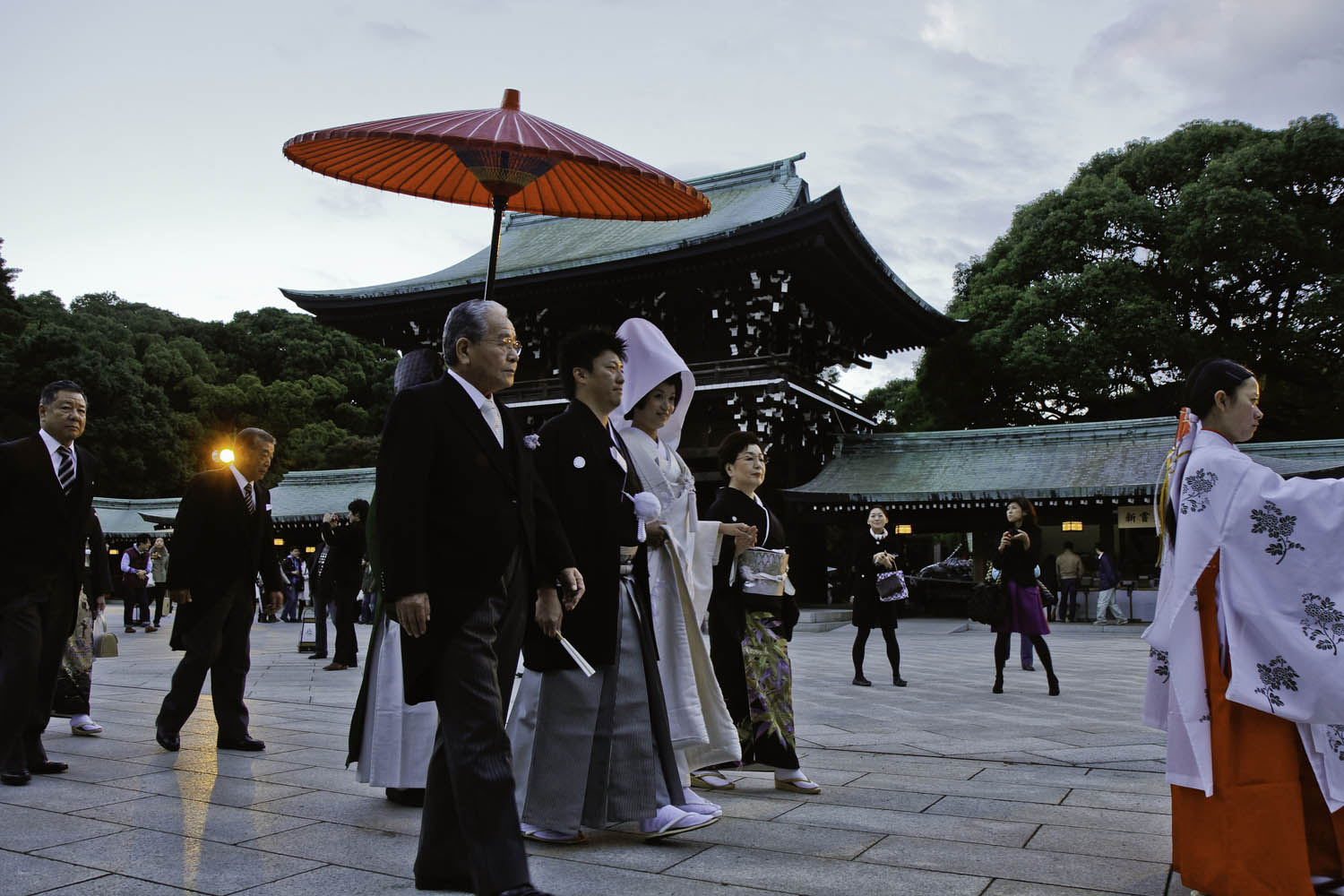 Bride and Groom Walk Through Meji Shrine
