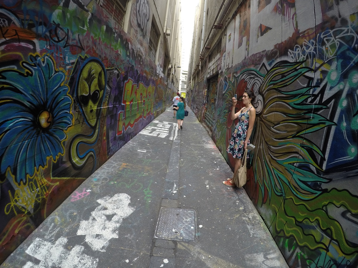 Woman photographing artwork in Union Lane