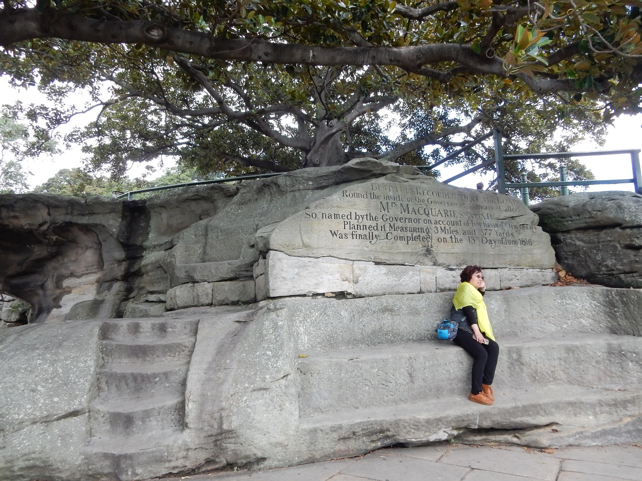 Tourist sitting on Mrs. MacQuarie's Chair