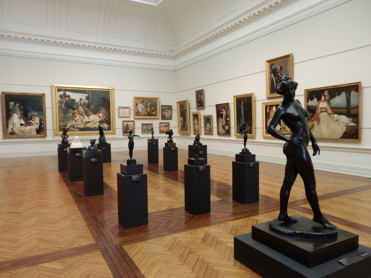 The museum has lots of paintings and statues on display