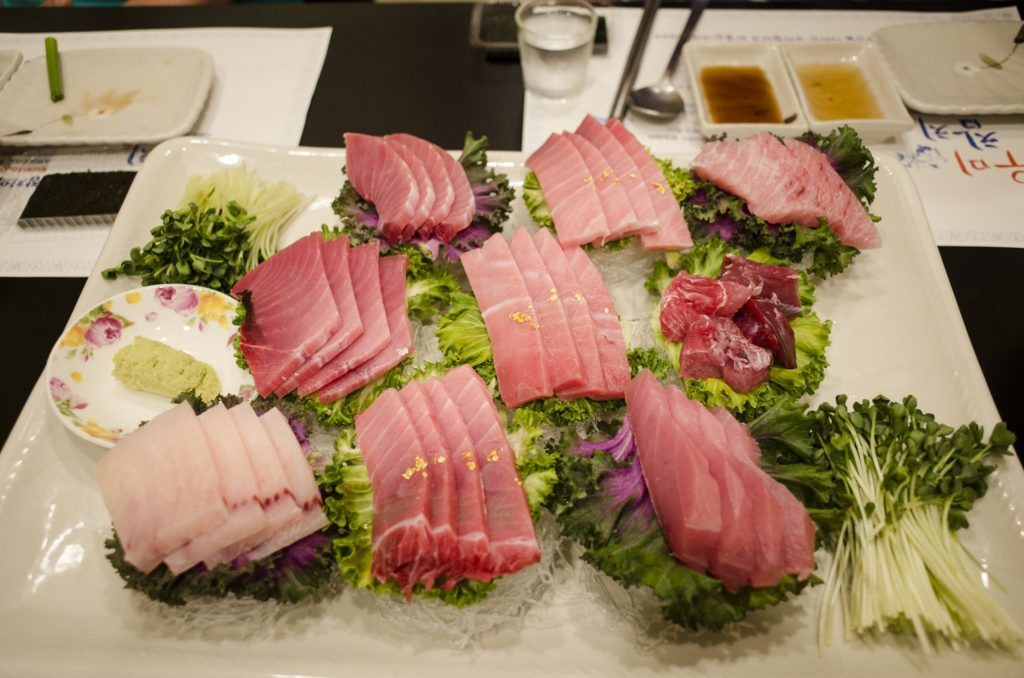 Any food tour of Japan must start with sampling local sushi shops. photo credit: [coolpix 우미참치 2015.05.28_8 via photopin (license)