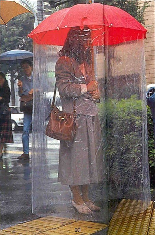 Okaaay, this is one invention that may have a market in the States. Don't you hate the fact that even with an umbrella, the bottom part of your cloths get wet? Well this invention is the answer to the problem. Please it doubles as a protector for your personal space!