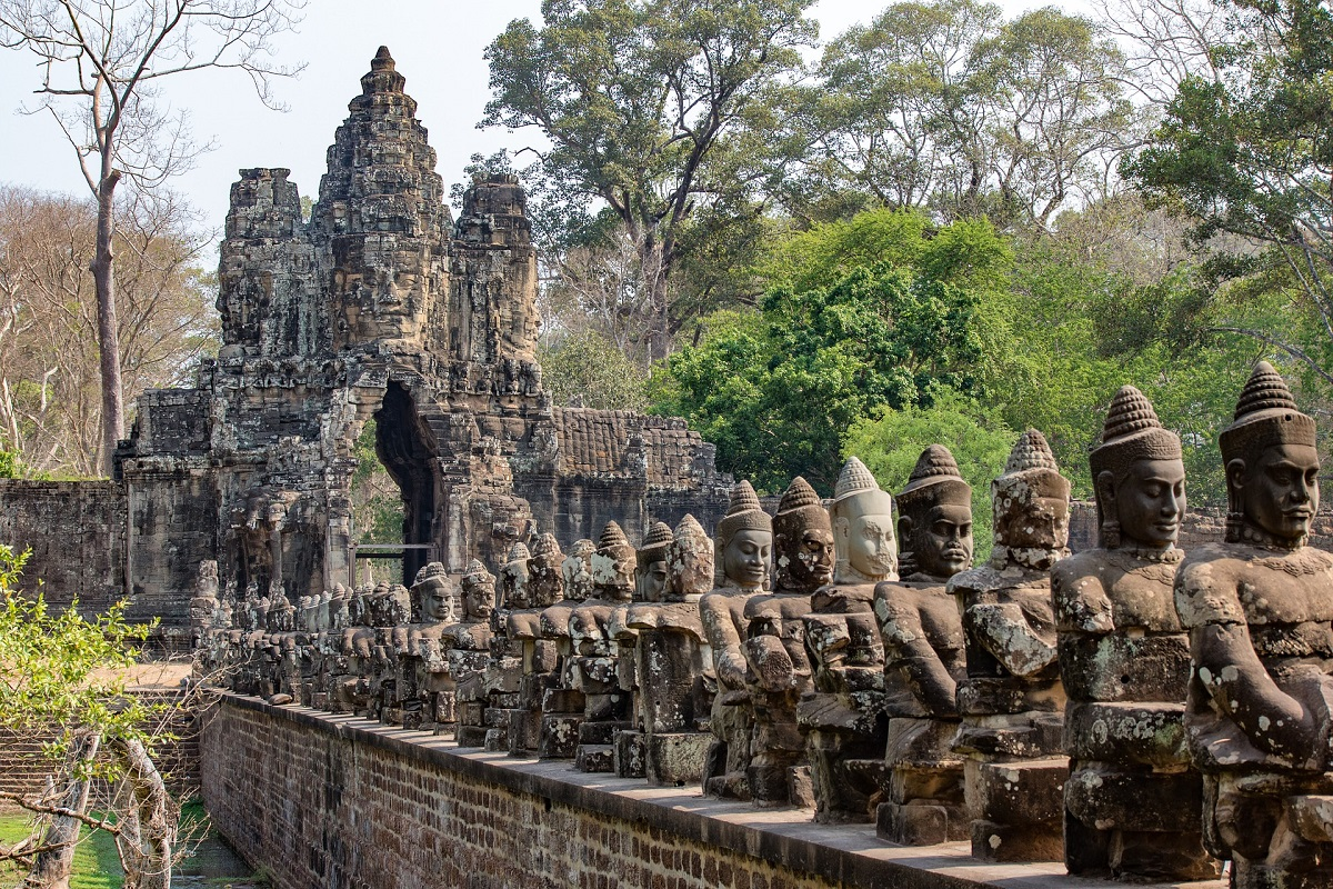 The statues of the Gods stand guard on the South Entrance of Angkor Thom